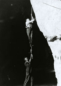 Wiburd & Edwards demonstrating the caving techniques employed to explore the River Cave and its branches.