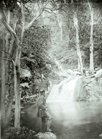 mid 1800s image of people standing by the waterfall along the Jenolan River
