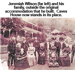 Jeremiah Wilson and family outside the original accommodation that he built.